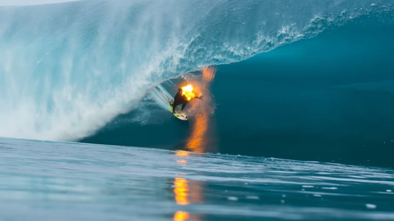Watch A Lunatic Surfer Light Himself On Fire And Ride A Huge Wave