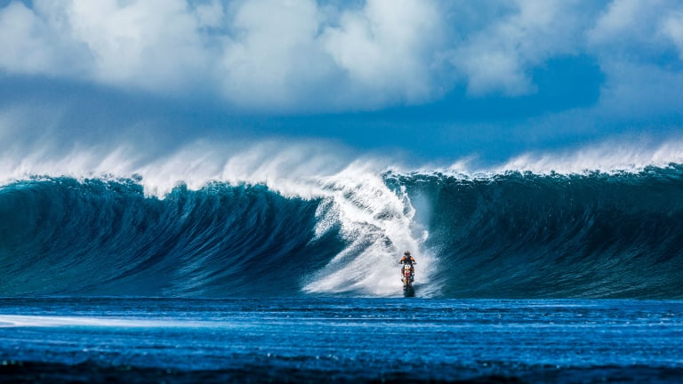Watching This Dude Surf Waves On A Motorcycle Is The Coolest Thing You'll See Today