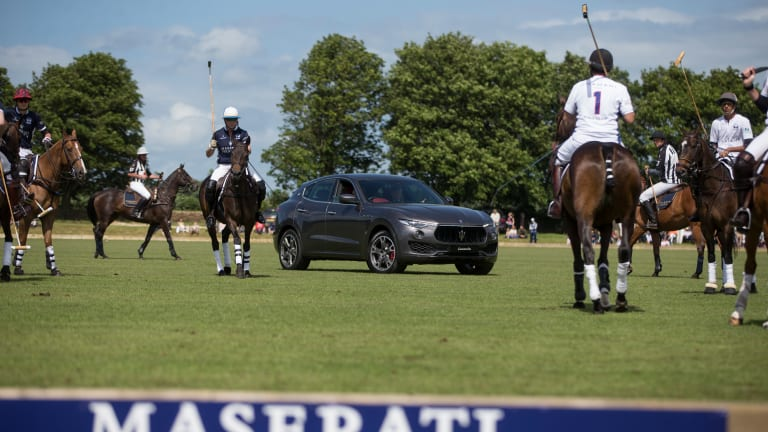 Watch the Maserati Levante Race Thoroughbred Horses Through the English Countryside
