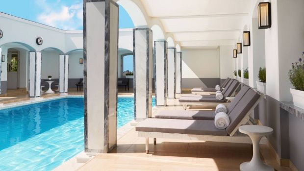 while-london-might-not-be-the-first-destination-you-think-of-when-it-comes-to-rooftop-pools-the-berkeley-hotel-in-london-boasts-a-health-club-spa-and-best-of-all-swanky-rooftop-pool-its-covered-in-iridescent-white-and-gold-mosaic-and-features-a-retra.jpg