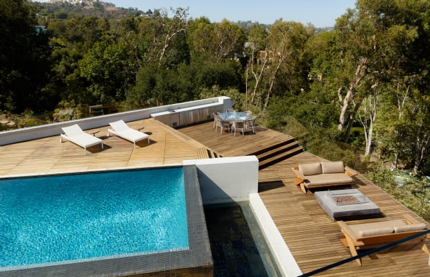 Grass-Covered Roof, Modern Style & Gorgeous Pool Deck: This Home Has It All