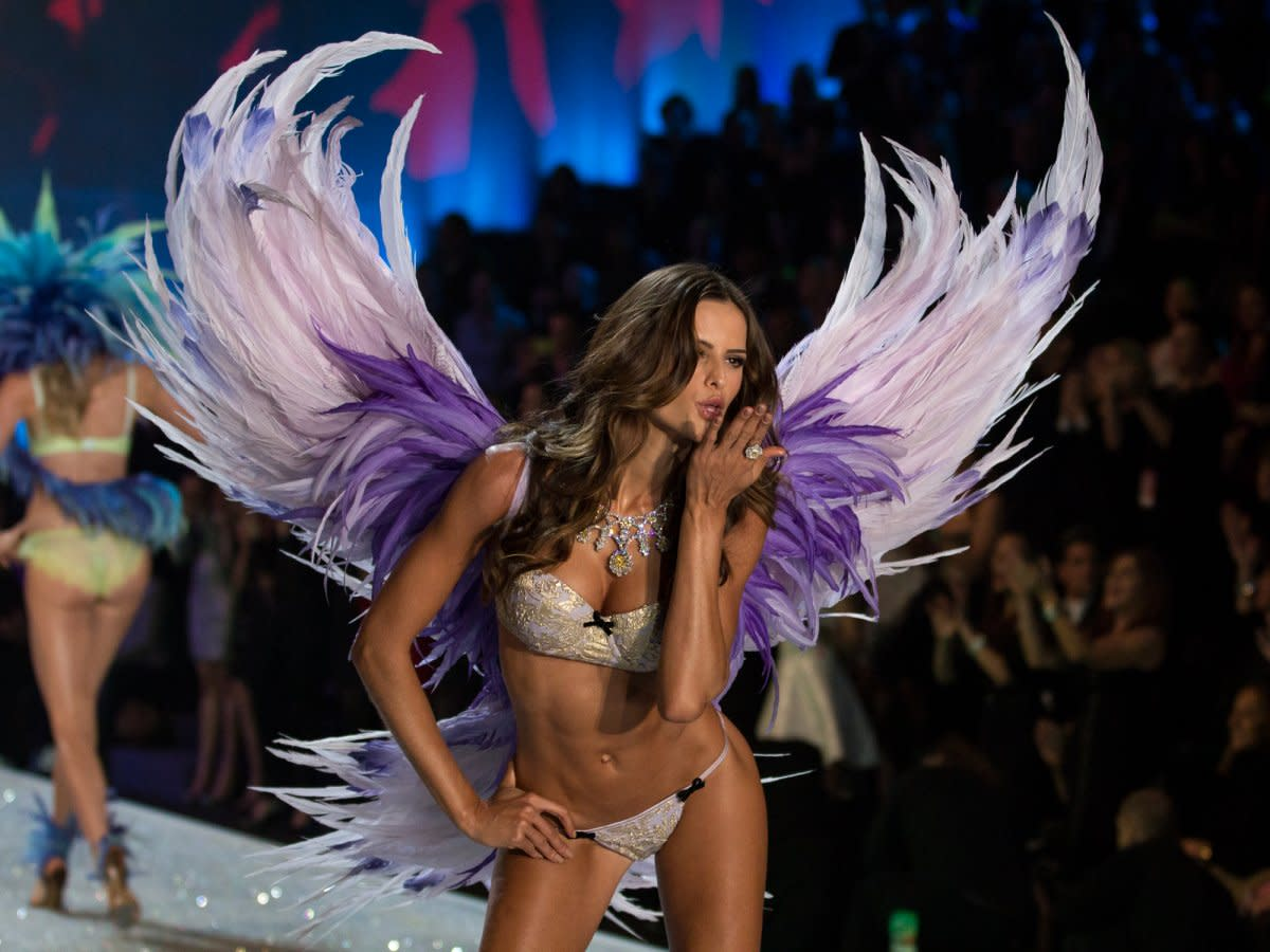 this-model-blows-a-kiss-in-her-pink-and-purple-wings