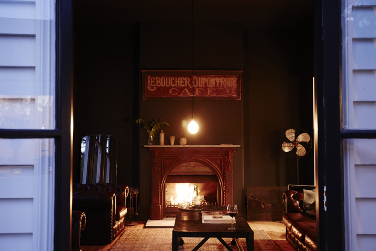 Antique fireplace in lounge room at Vintage House Daylesford