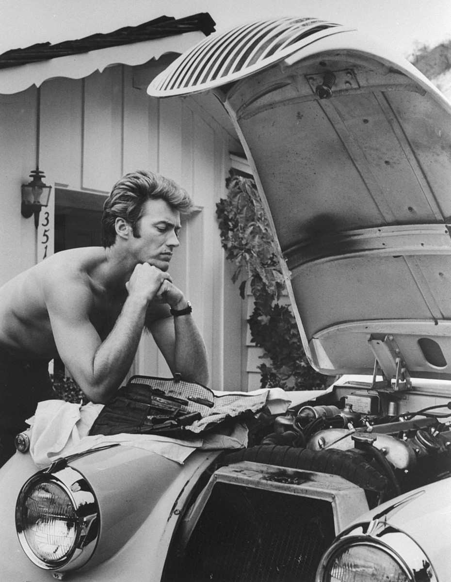 Clint Eastwood Works On His Car